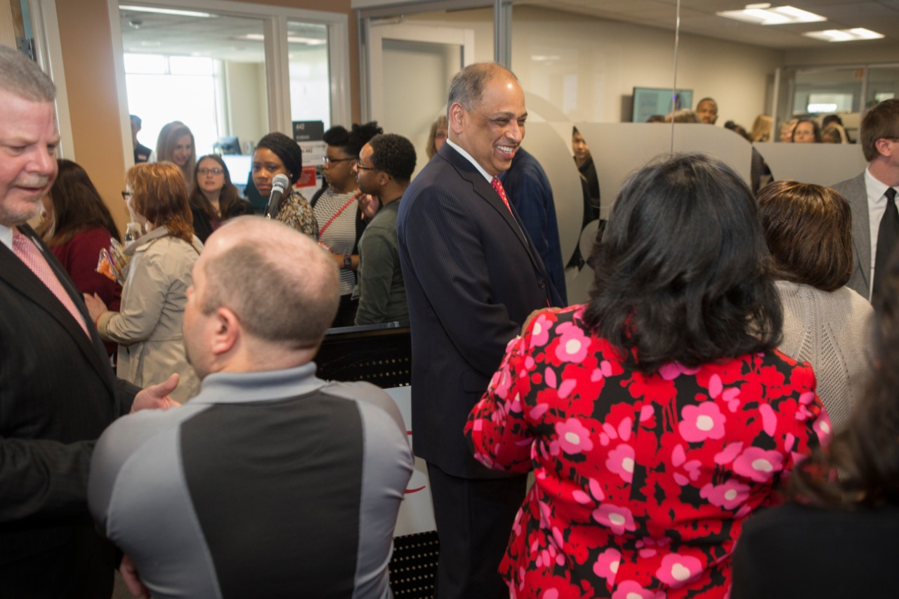 UC President Neville Pinto speaks with UC staff at the Staff Success Center ribbon cutting event.