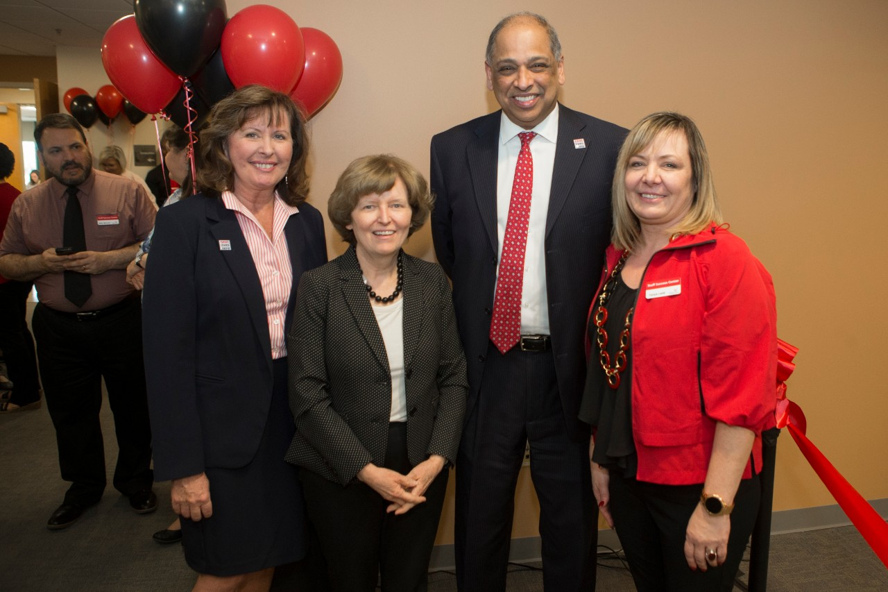 UC President Neville Pinto and other administrative members at the Staff Success Center ribbon cutting event.
