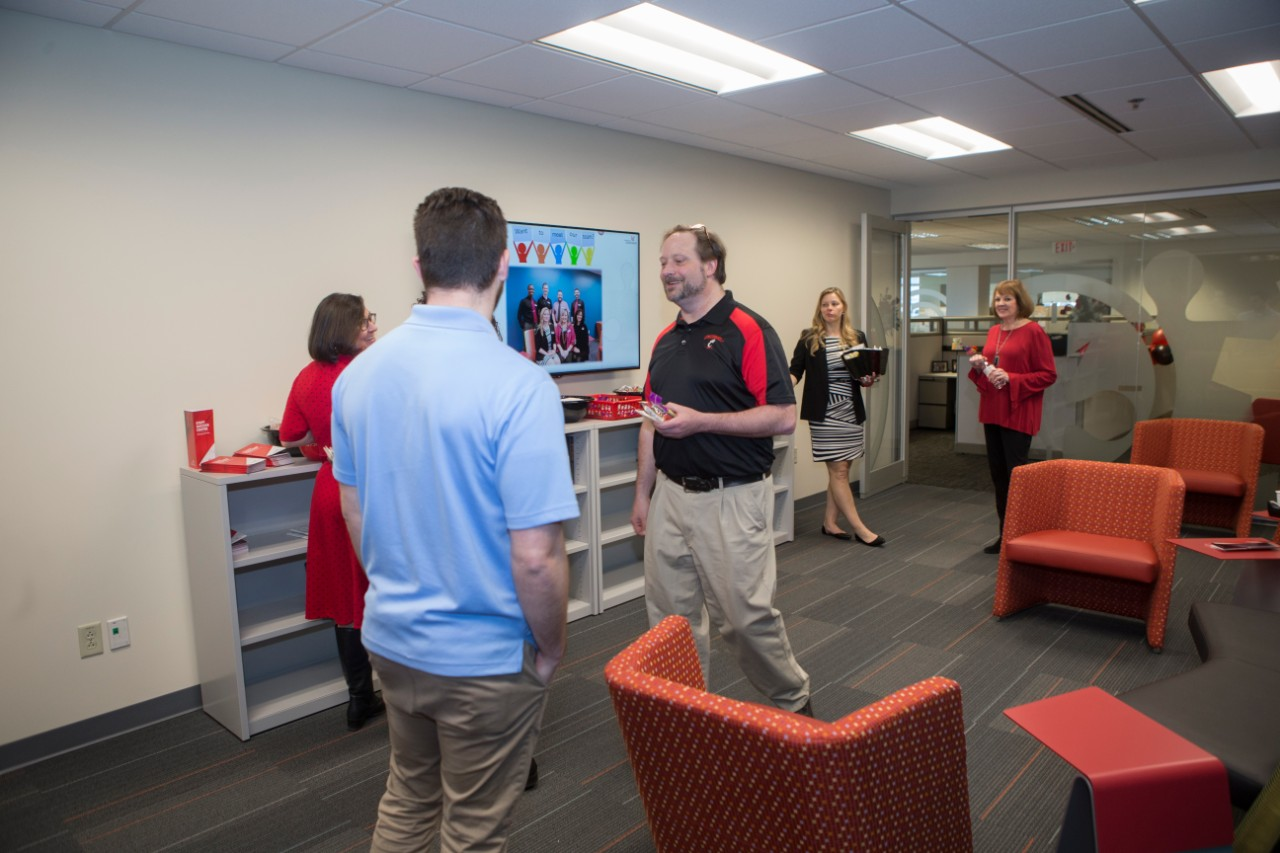 UC staff members enjoy themselves at the Staff Success Center ribbon cutting event.