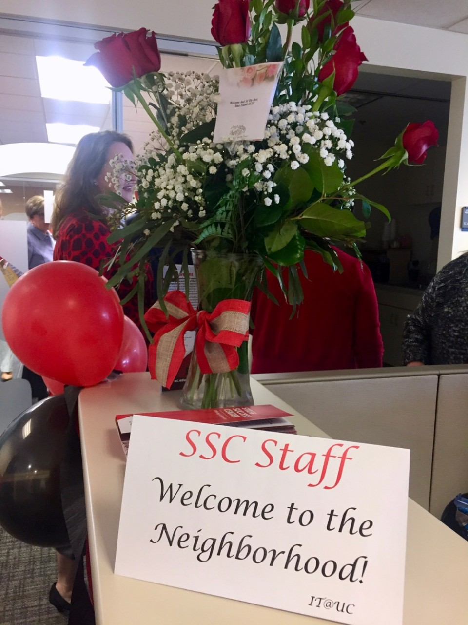 A dozen roses grace the entryway at UC's new Staff Success Center.