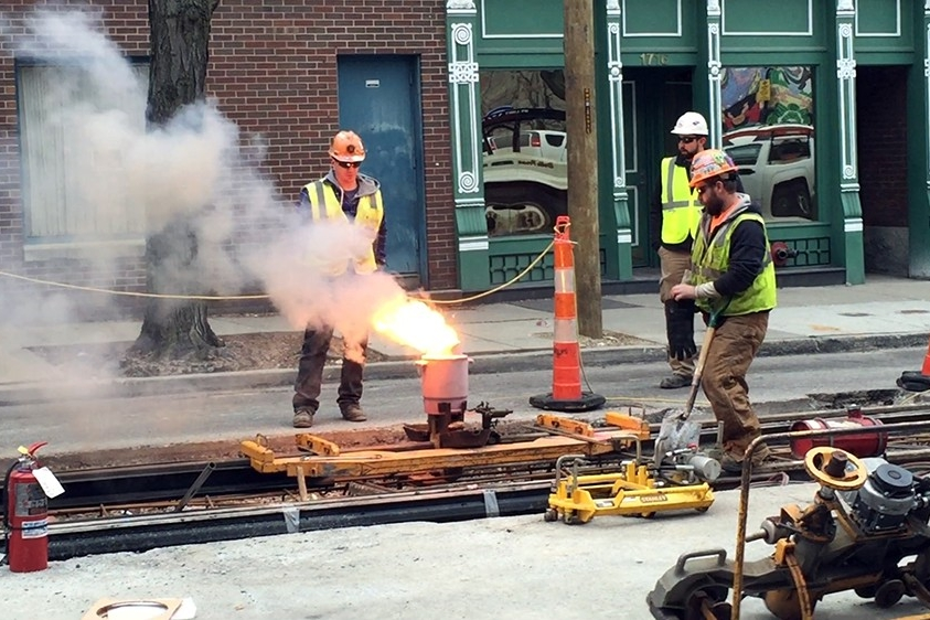Crews use a process known as thermite welding to connect two steel rails together. Shown is the final weld in the Over-The-Rhine segment, December 15, 2014.