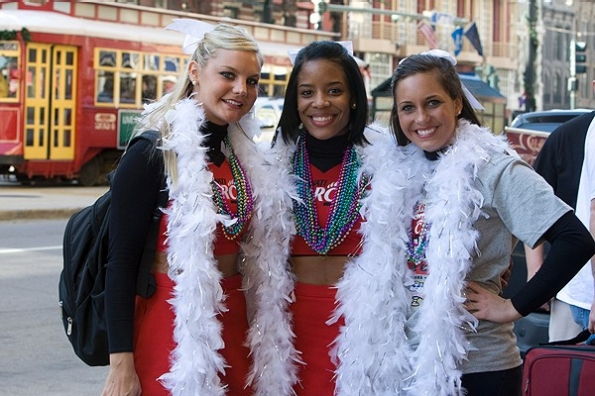 UC cheerleaders pose on Bourbon Street.