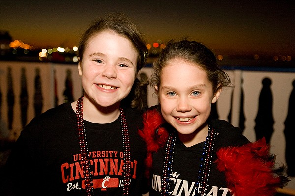 Young fans on a bayou cruise sponsored by the UC Alumni Association.