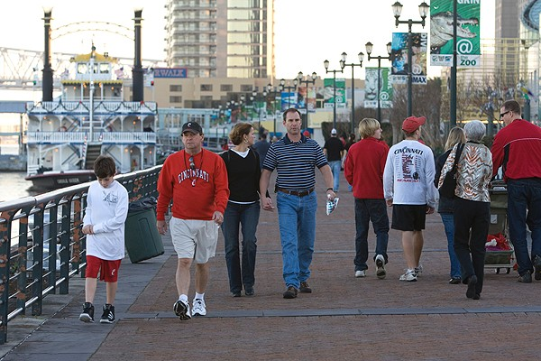 UC fans near New Orleans' Riverwalk, a shopping and entertainment complex along the bayou.