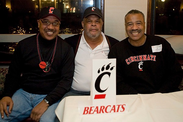 Three 1971 UC Bearcats football players, including Jesse Taylor, middle, and Al Johnston, at right, enjoy the New Year's Eve cruise.
