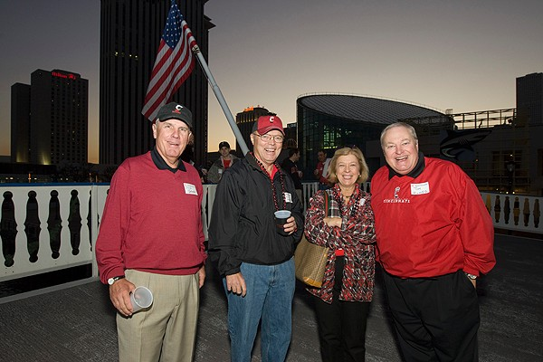 UC Board Trustee Tom Humes, BusAd '71, MA (A&S) '77, right, with his wife and other alumni on the New Year's Eve bayou cruise sponsored by the UC Alumni Association.