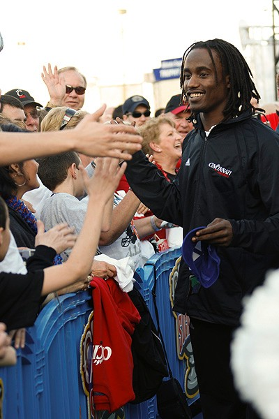 Bearcats senior wide receiver Mardy Gilyard greets fans at the team's pep rally in Jackson Square on December 31, 3009.
