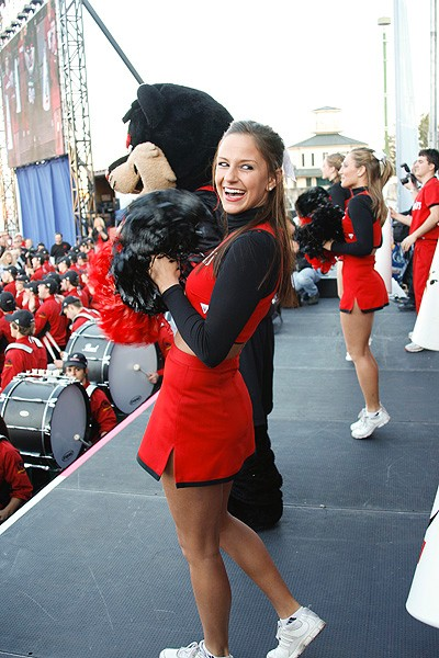 UC cheerleaders on stage with the Bearcat at the pep rally in Jackson Square.