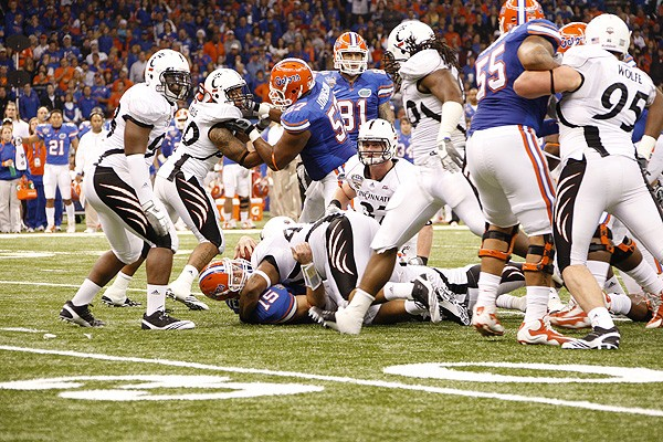 The Bearcats tackle Florida's Tim Tebow. UC's Alex Daniels completed two sacks on the day.