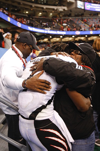 Mardy Gilyard embraces his mom after the loss. Gilyard's next stop will be the NFL.