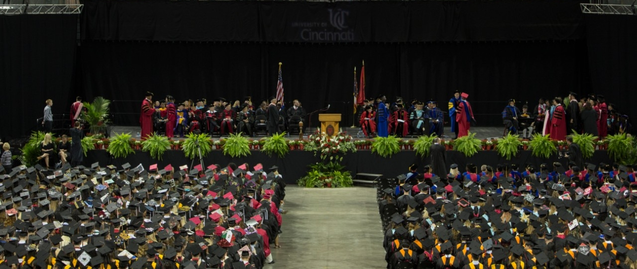 Graduates in black caps gather at BB&T Arena for summer Commencement