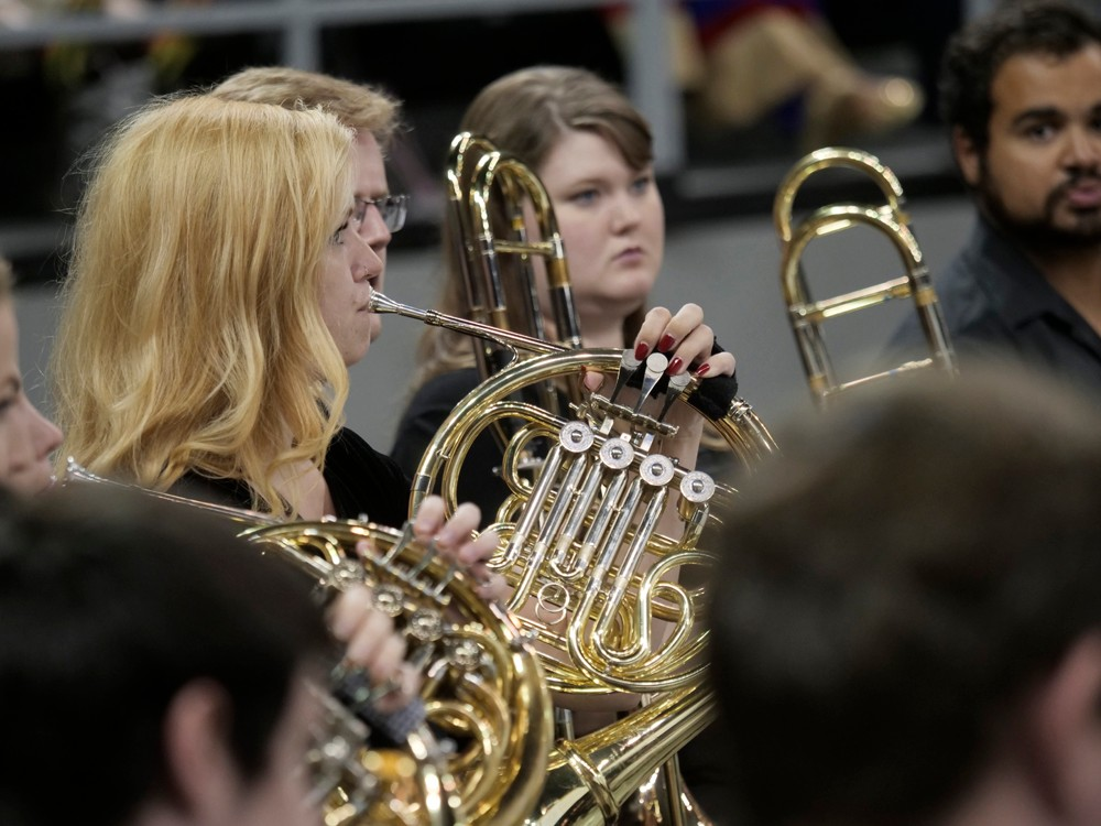 A musician plays the French horn