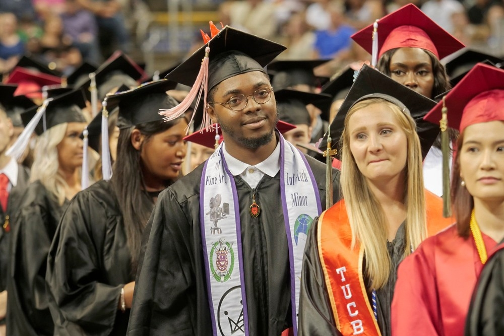 Graduates file into the arena at commencement.