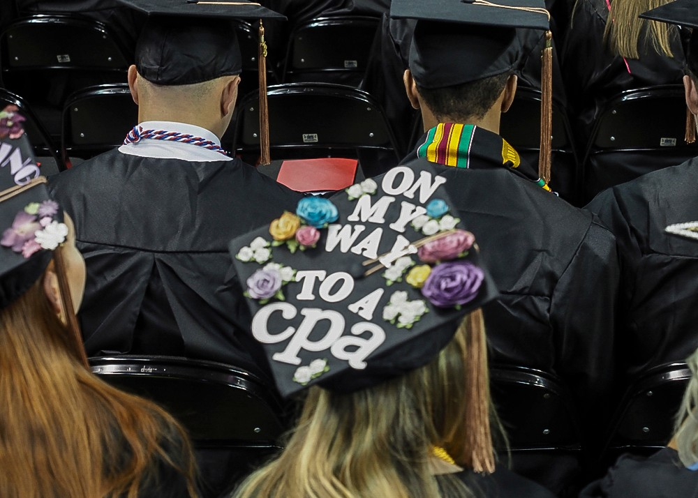 A decorated mortarboard that reads On my way to a CPA