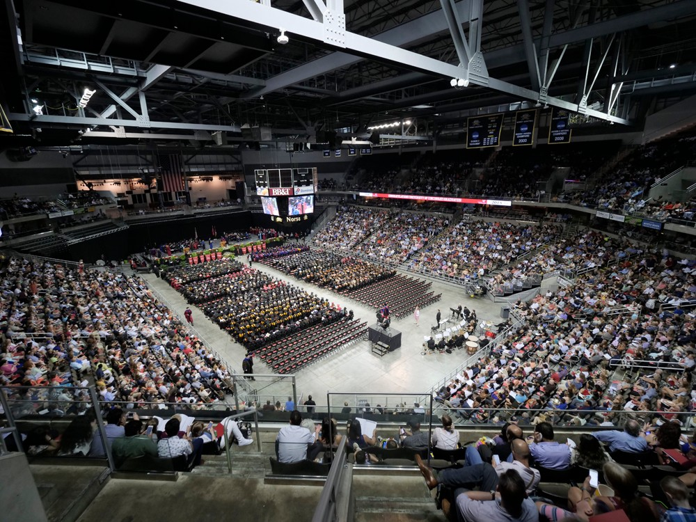 A wide shot of commencement taken from the upper deck at BB&T Arena.