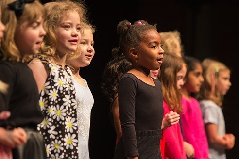 Children enjoy singing on stage at UC's CCM summer camp.