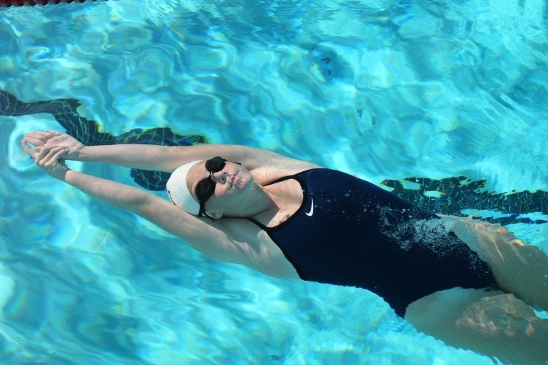 Young swimmer does the back stroke during UC's Cincinnati summer swim camp.