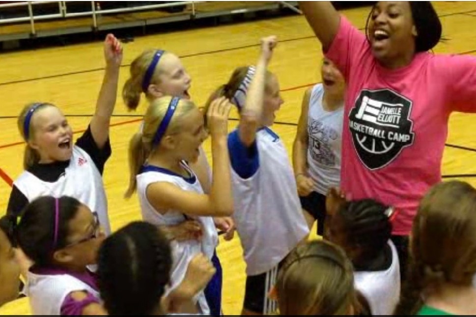 Girls cheer as they learn new skills on UC's basketball court during summer camp.