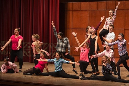 Teens perform on stage at UC CCM's summer camp for theater arts.