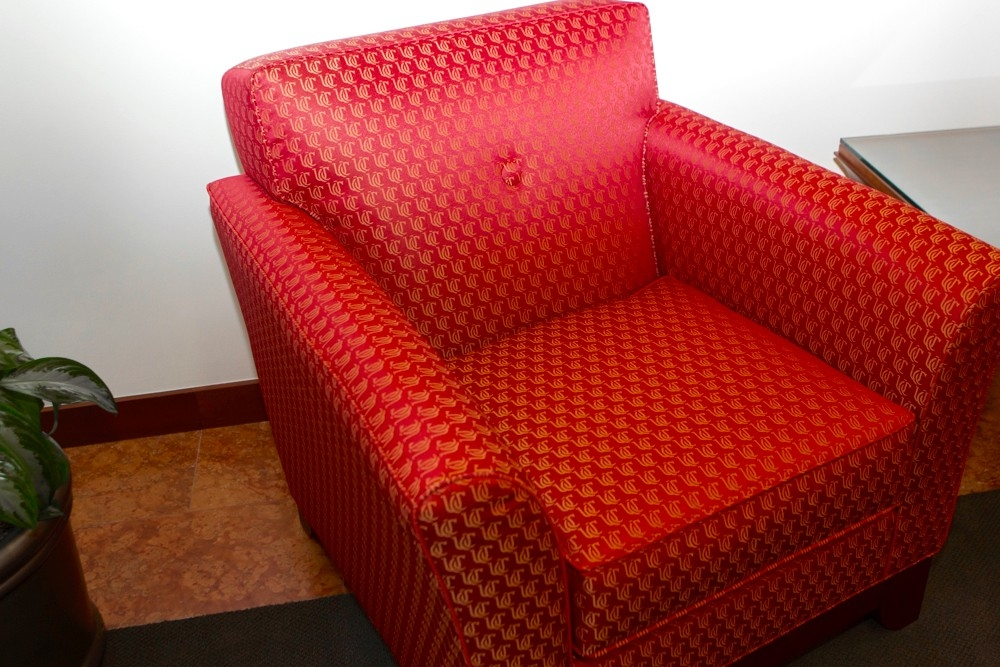 Chair covered in red UC logo-designed upholstry