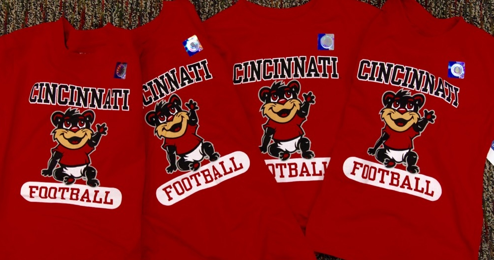 Red children's T-shitrs with animated UC Baby Bearcat trademark image in front