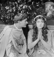 Theda looking innocent as Juliet, appearing with Romeo.