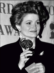 Faith at the Tony Award ceremony clutching her award.
