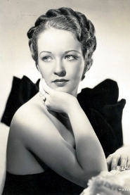 Portrait of Evelyn wearing a strapless black gown.