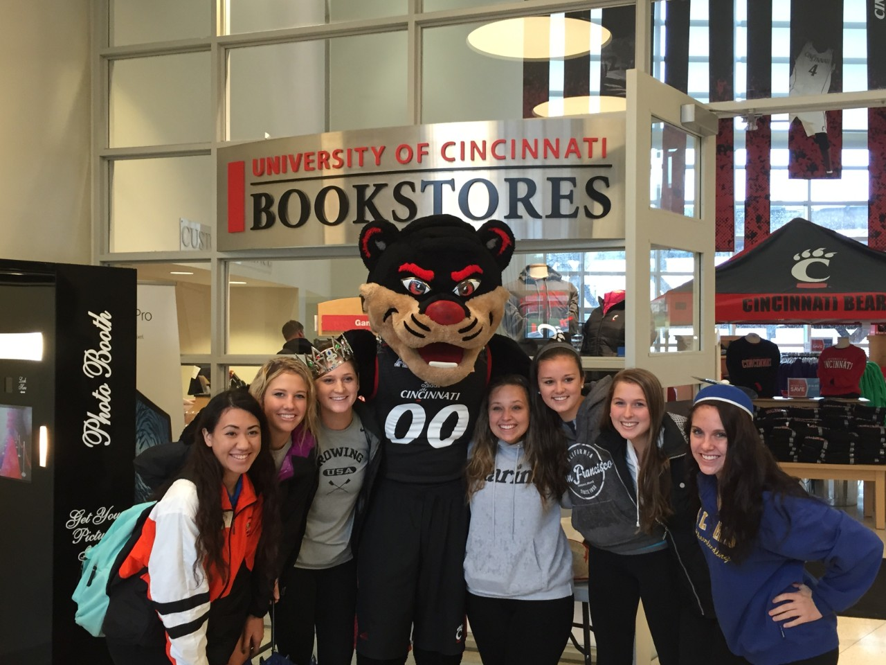 UC students and the Bearcats mascot inside the UC Bookstore