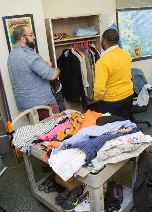 Sol Ouzounian and Lee Dyer sort through clothing donations.