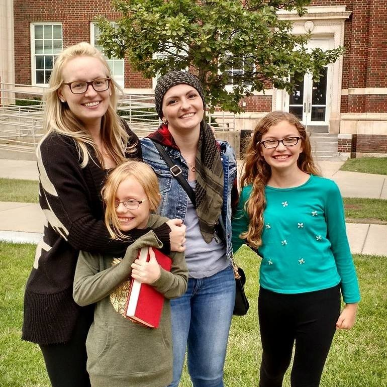 Tori Thomas on campus at UC with her three sisters.