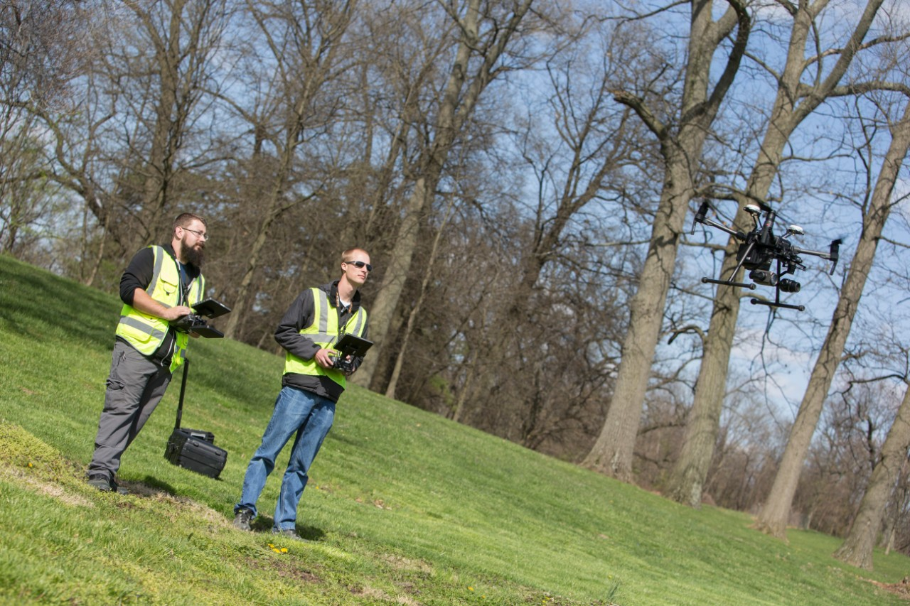 UC research associate Bryan Brown, left, and UC engineering student Austin Wessels operate a drone the university is using to capture traffic data and images for the Ohio Department of Transportation.