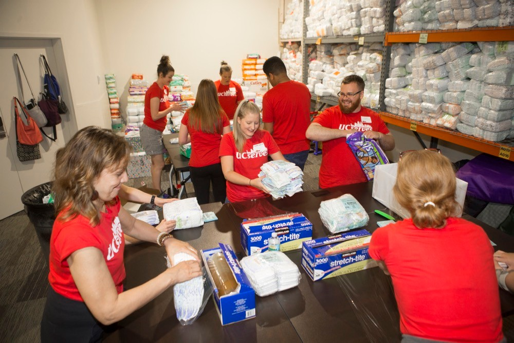 UC Serves package boxes of diapers in Sweet Cheeks Diaper Bank on UC Serves Day. photo/Joseph Fuqua II/UC Creative Services
