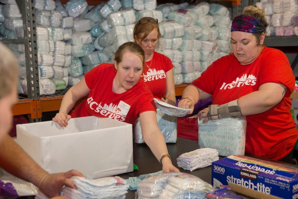 UC Serves volunteers package boxes of diapers for the Sweet Cheeks Diaper Bank on UC Serves Day. photo/Joseph Fuqua II/UC Creative Services