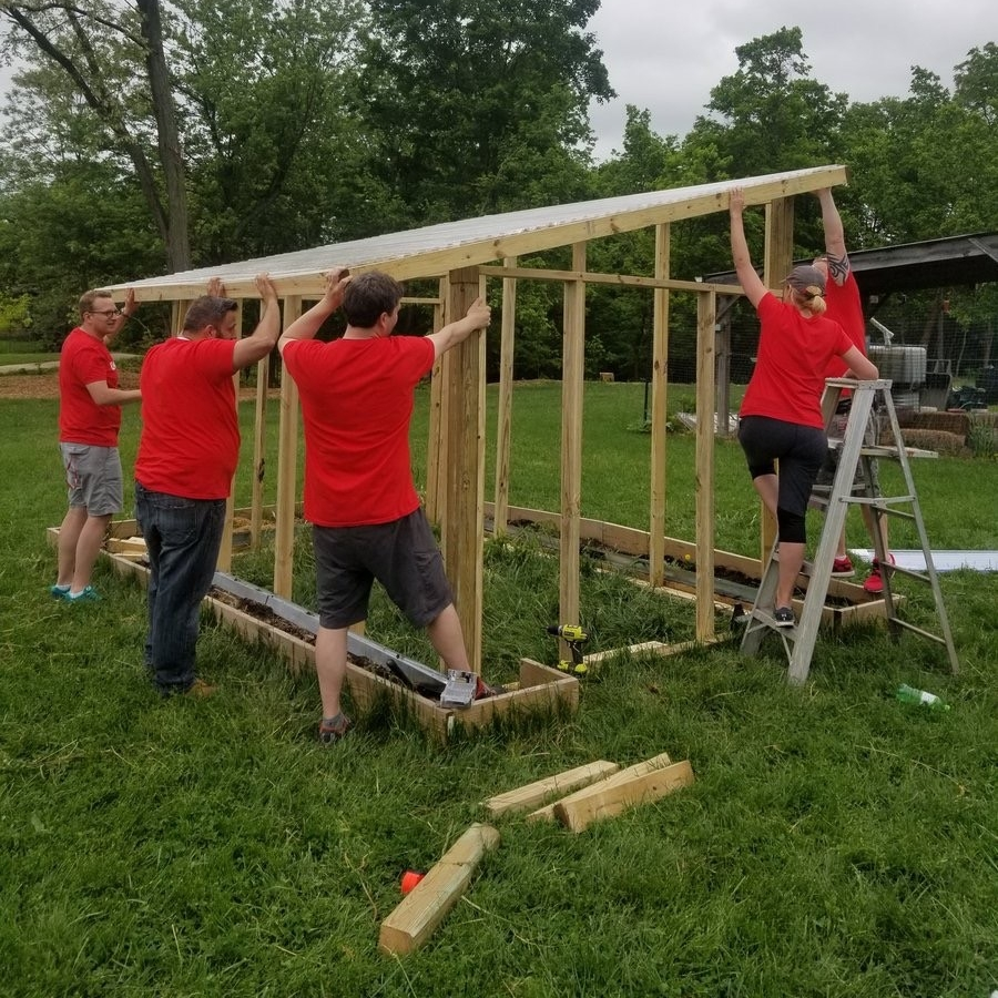 UC Serves volunteers build a greenhouse at Pleasant Hill Elementary School.