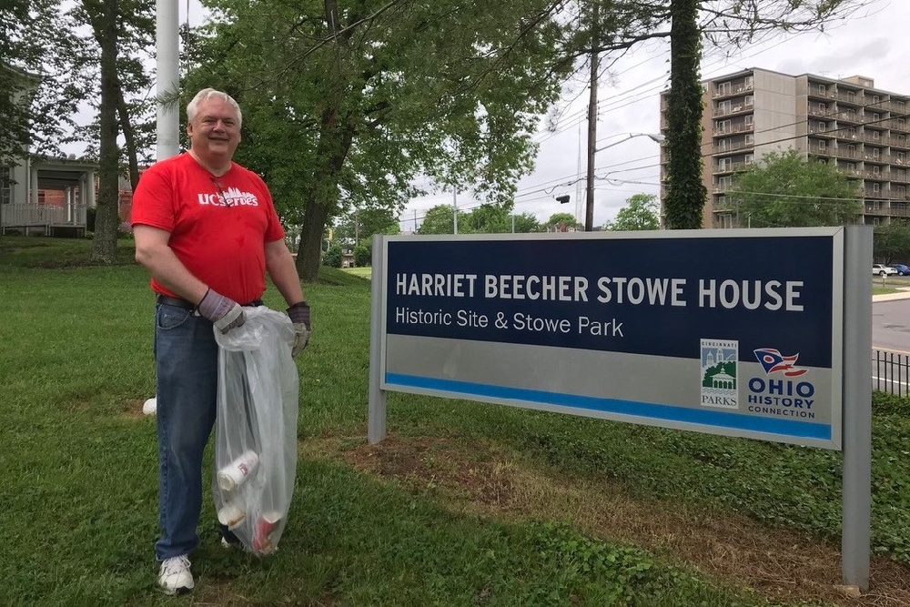 James Whalen, director of UC Public Safety helps spruce up the grounds around the Harriet Beecher Stowe House.