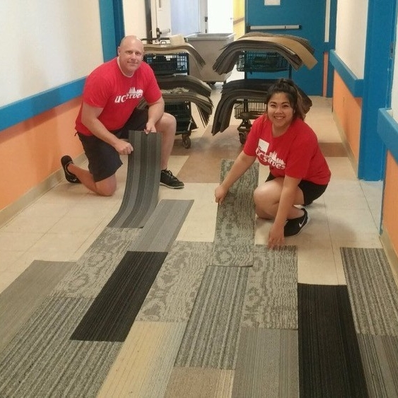 UC Serves volunteers lay carpet strips at Cincinnati's Urban Promise on UC Serves Day.