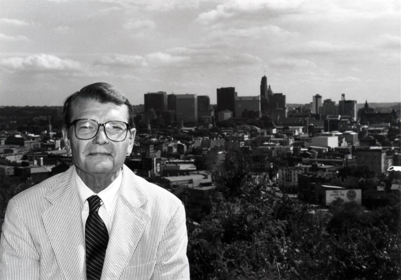 Zane L Miller sitting in front of Cincinnati skyline