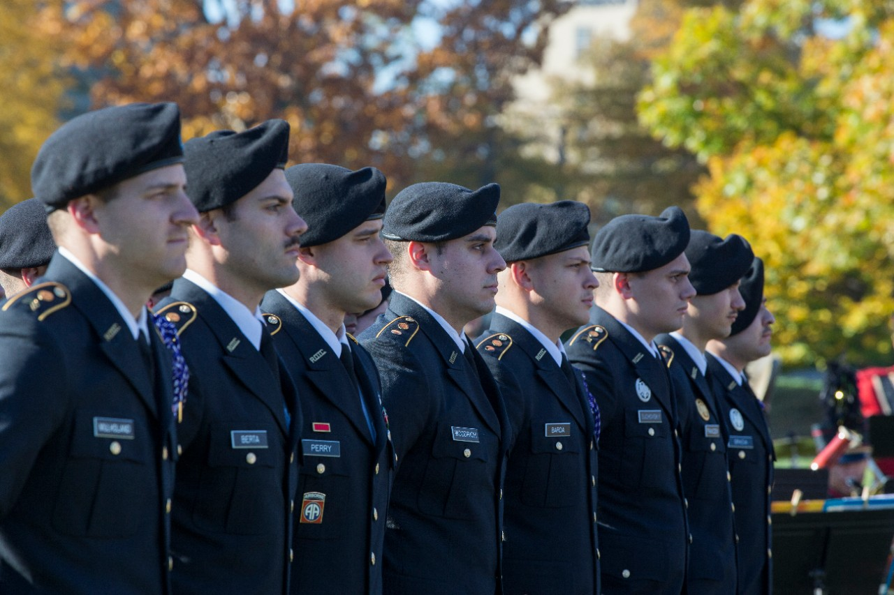 Army ROTC cadets stand at attention.
