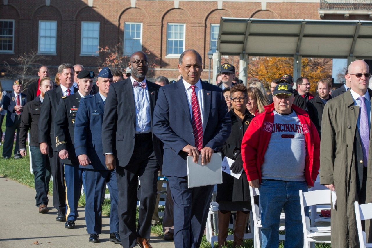 UC President Neville Pinto, Veterans Programs & Services Director Terence Harrison and the ceremony's guest speakers make their way to the stage.