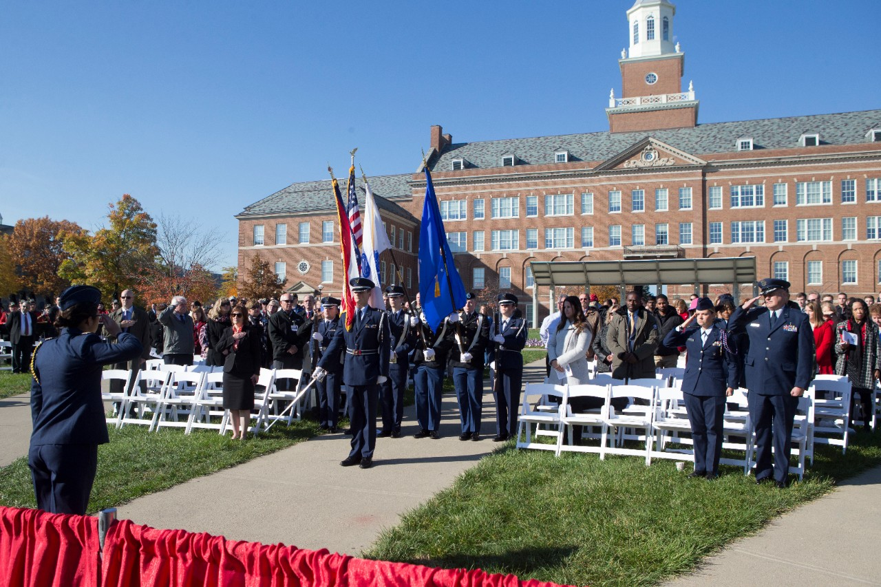 A Color Guard holding colorful flags pays tribute to the nation's veterans.