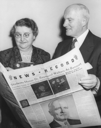 President and Mrs. Raymond Walters hold a special souvenir edition of The News Record, presented to the couple at the president's student-sponsored retirement dinner in 1955.