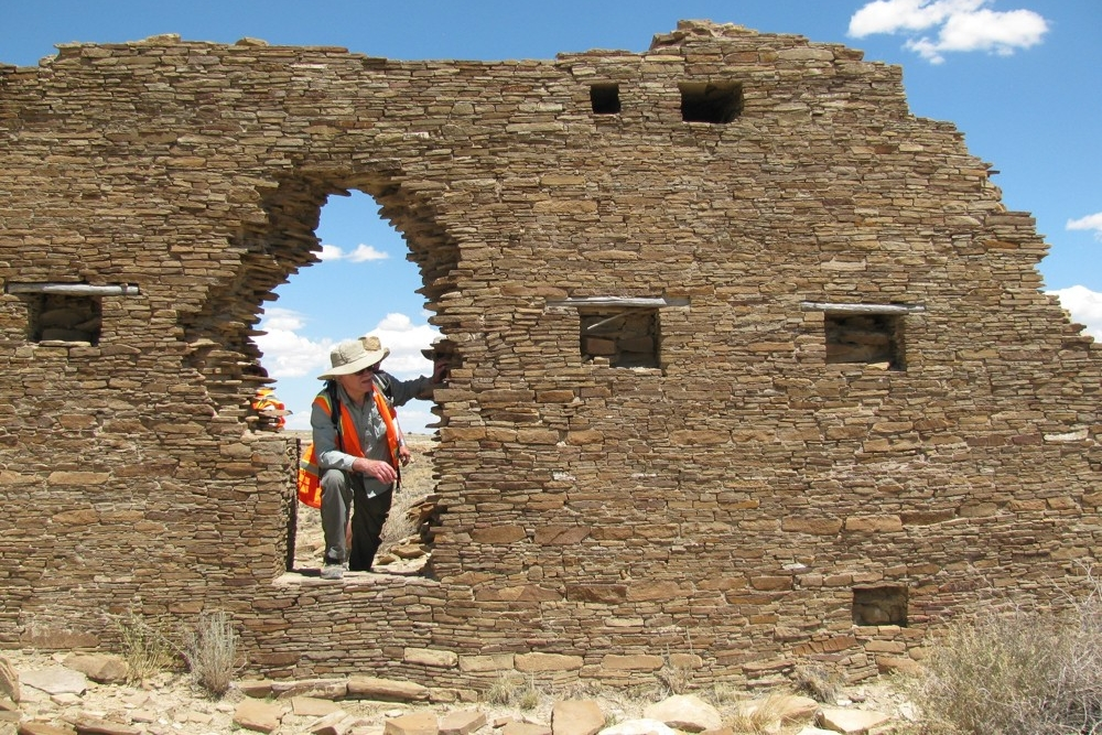 UC professor Vern Scarborough stands in the doorway of a Great House in Chaco Canyon, New Mexico.
