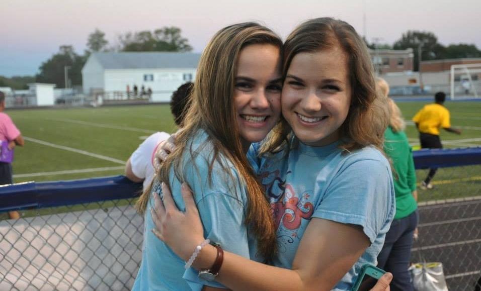 Sara Whitestone hugs her younger sister Hope