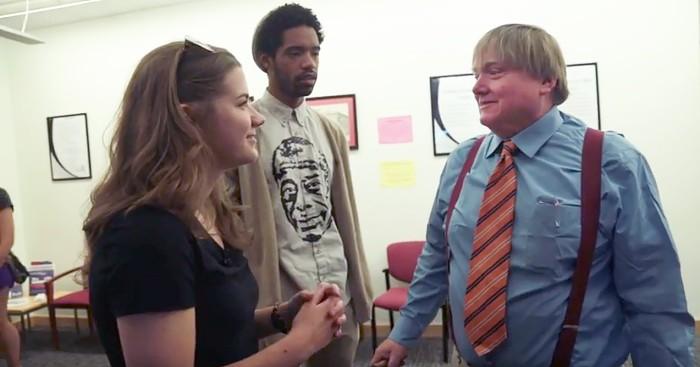 Sara and a friend talk with Matthew Sauer
