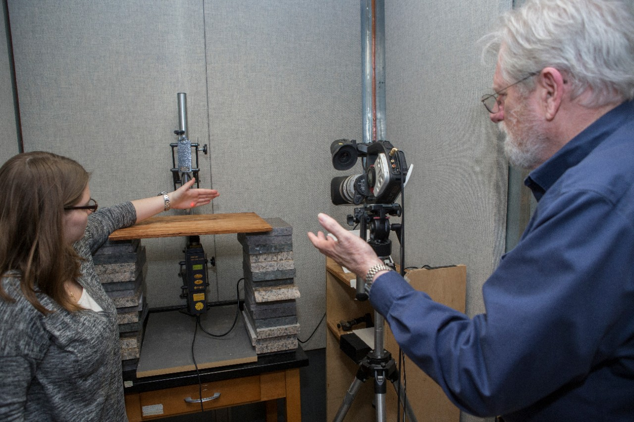 Biology researchers set up a laser doppler vibrometer in a soundproof room in the biology lab to study the vibrations that courting spiders make in the soil or fallen leaves.