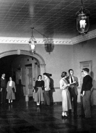 Students standing inside McMicken Hall's 1st floor in 1950.