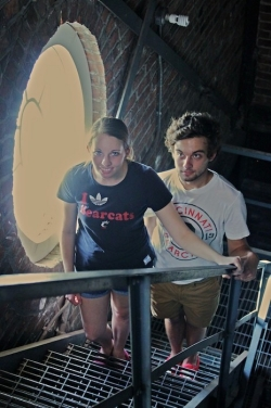 UC students Katie and Austin Dew climb the stairs to the top of the Christopher Wren Tower on top of McMicken Hall in 2014.