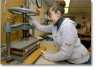 Jessica Justice repairs a book photo/Dottie Stover