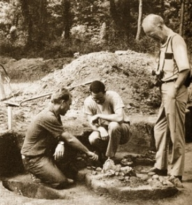 Gustav Carlson examines the findings of a student dig.